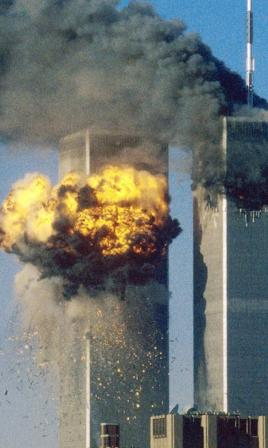 The iconic twin towers in flames after attack by terrorists - the first such on US soil, killing more than three thousand.