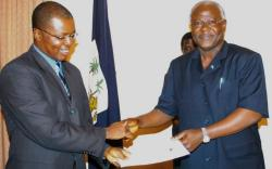 The ACC boss and the President - Photo: AWOKO