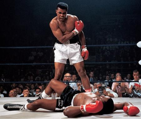 One of the most iconic photographs in the world of boxing. Sonny Liston floored by the Louiseville Lip in the 60's.