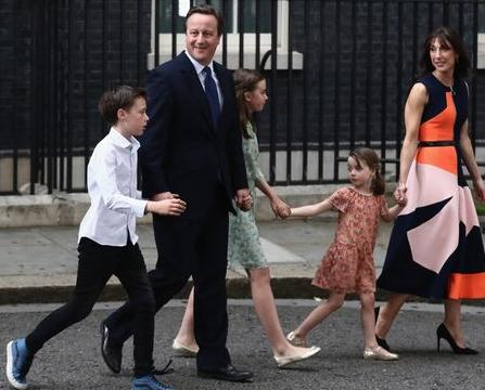 David Cameron and family take a bow from 10 Downing Street.