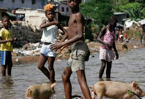 While children and pigs roam the sources of drinking water in Freetown, US APC party activists deny there's any cholera afflictions or deaths in Sierra Leone.