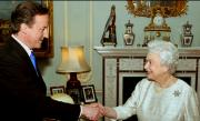 The UK's new Prime Minister Dvid Cameron with Her Majesty the Queen