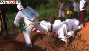 Sky TV picture of the burying of the dead under secured conditions.