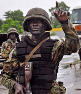 The face of terror? This soldier in Liberia enforcing movement restrictions in the country. Can they be trusted not to abuse the rights of civilians in Liberia?