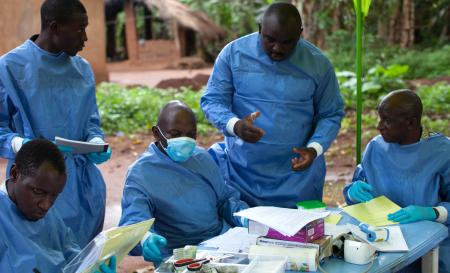 Billo Mamadou Diallo, Karamoko Sonah Camara, Alain Mukendi, Jean Francoi Tolno and Hawa Madi, Team 9 of the WHO Ebola vaccine trial, at work in Katongourou, Guinea.