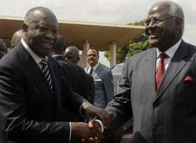 Former President Laurent Gbagbo on the left of picture...and on the right...