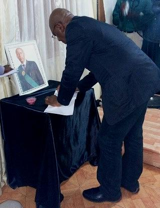 AWOKO editor Kelvin Lewis signs the book of condolence for journalist Samuel John