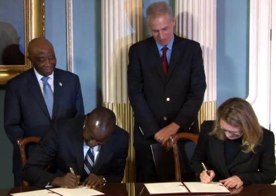 The signing of the Liberia protocol.