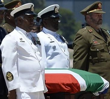 Madiba's remains in coffin draped in the South African flag. RIP