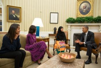 Malala with President Barack Obama and two family members.