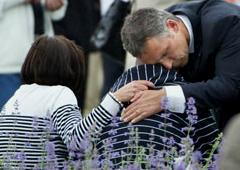 Norwegian PM Jens Stoltenberg comforts a survivor. Norway is in national mourning