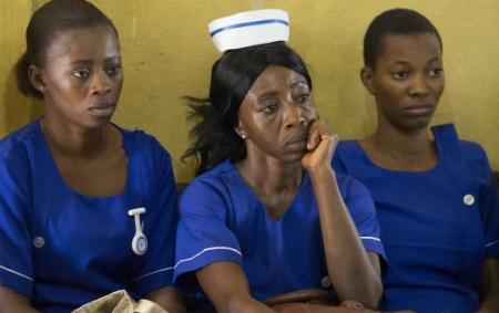 The faces tell the story. It is not an easy and comforting task tackling Ebola but these brave people soldier on nevertheless. We salute all of them.