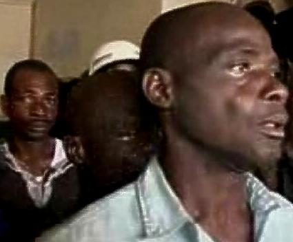 Terrified SLPP supporters in March 2009 as their party office in Freetown is attacked by the police and APC supporters