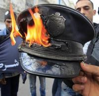 The symbol of repression - the police - a cap gets the treatment