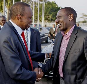 Uhuru the lying jackal in a handshake with another ICC accused wretch William Ruto before leaving for Saturday's meeting at the African Union in Addis Ababa.