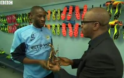 Yaya Toure receives the BBCAfrican Footballer of the Year award from ace sports journalist Peter Okwoche. Well done Yaya, well done.